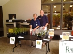 Colin Hingley and John Miller with the milkweed from Jenkins Arboretum & Gardens